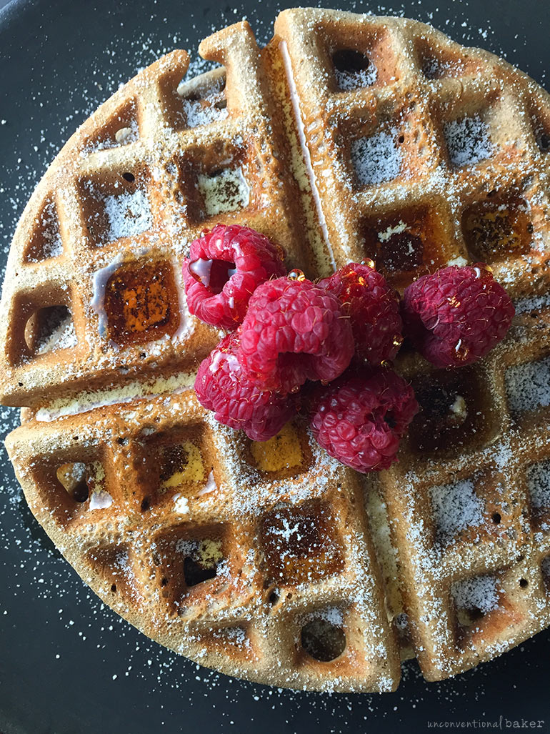 gluten-free vegan waffles with maple syrup and raspberries refined sugar-free