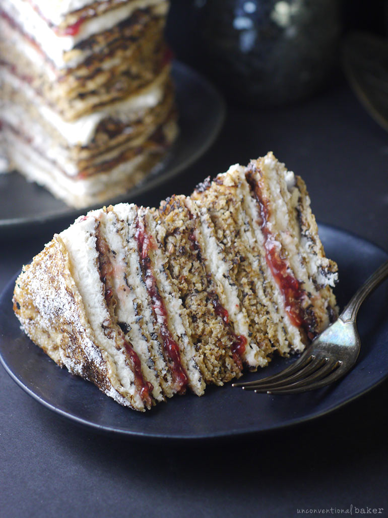 slice of vegan crepe cake with raspberry and whip (gluten-free)