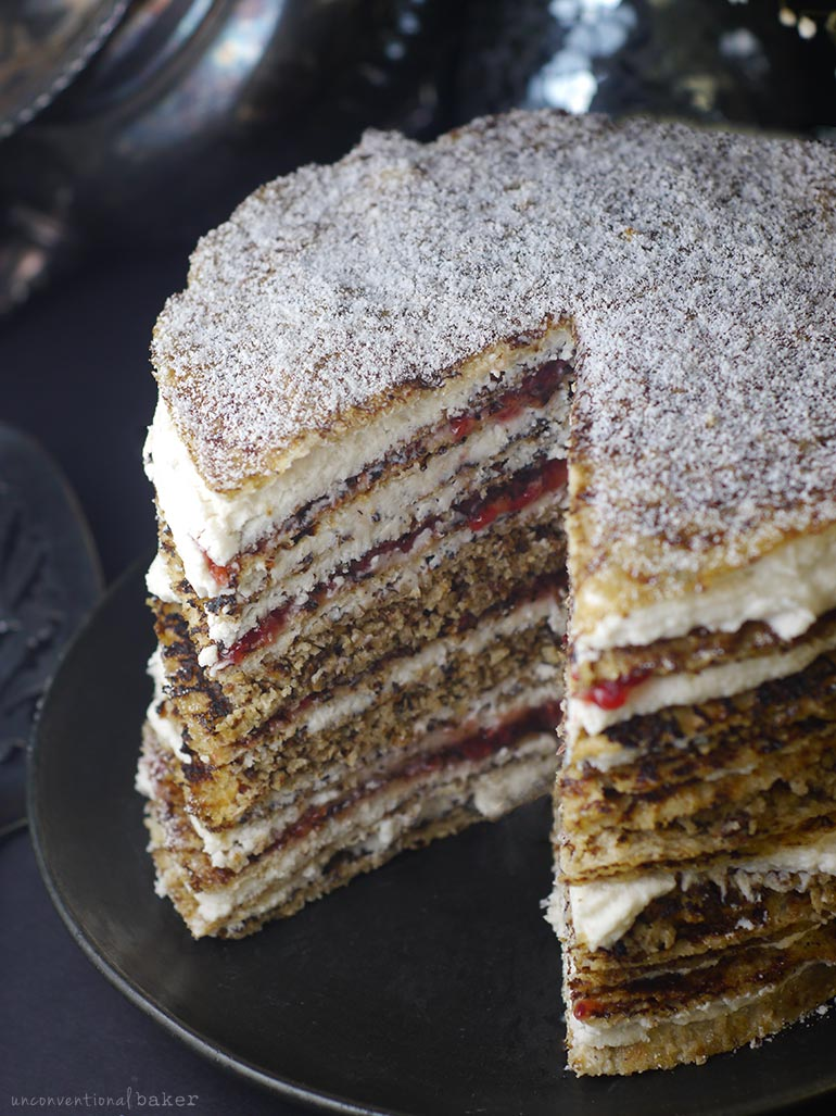 gluten-free vegan cake with layers of crepes raspberry and coconut whip