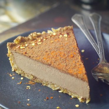 slice of chocolate mousse tart made with vegan paleo and gluten-free recipe