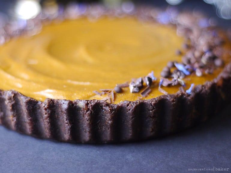 peanut butter pumpkin pie inside a gluten-free vegan brownie crust