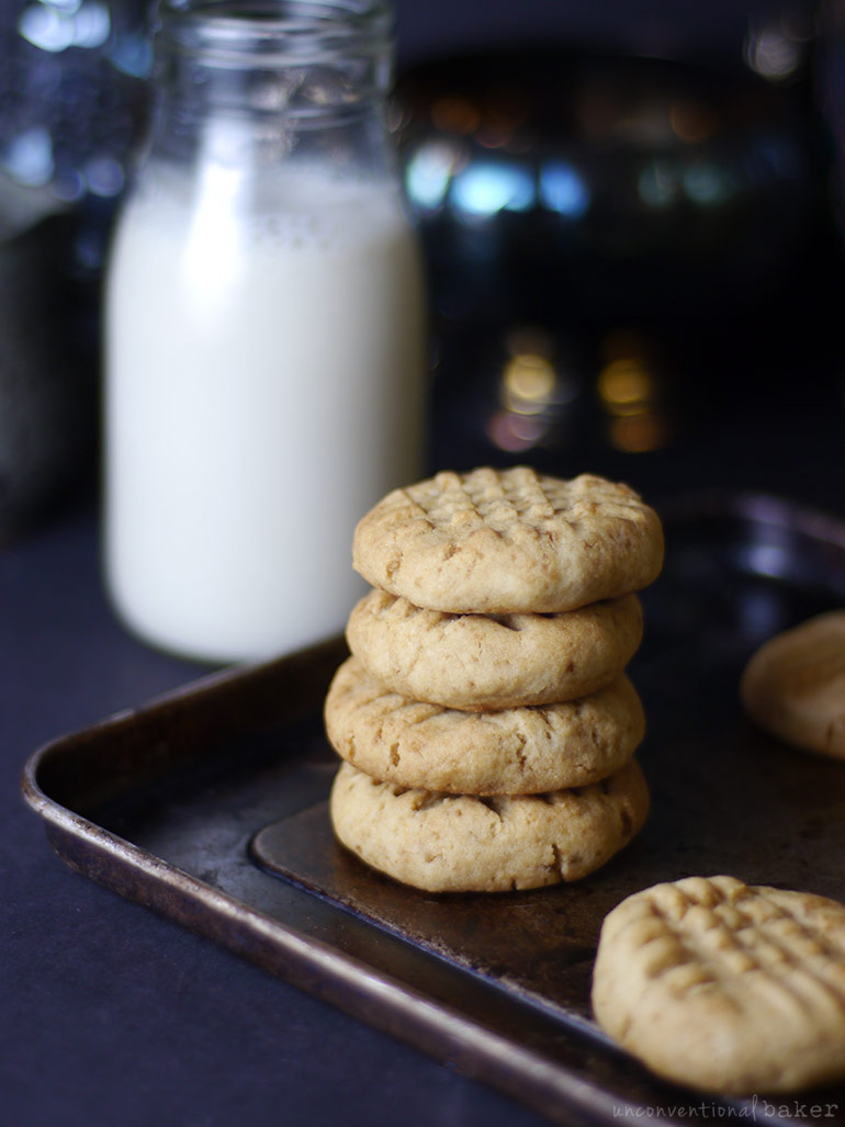 vegan gluten-free peanut butter cookies recipe -- stacked on a tray