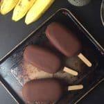 vegan banana peanut butter ice cream pops covered in dark chocolate